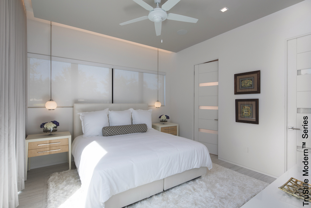 white modern guest suite in refinished basement with lighting