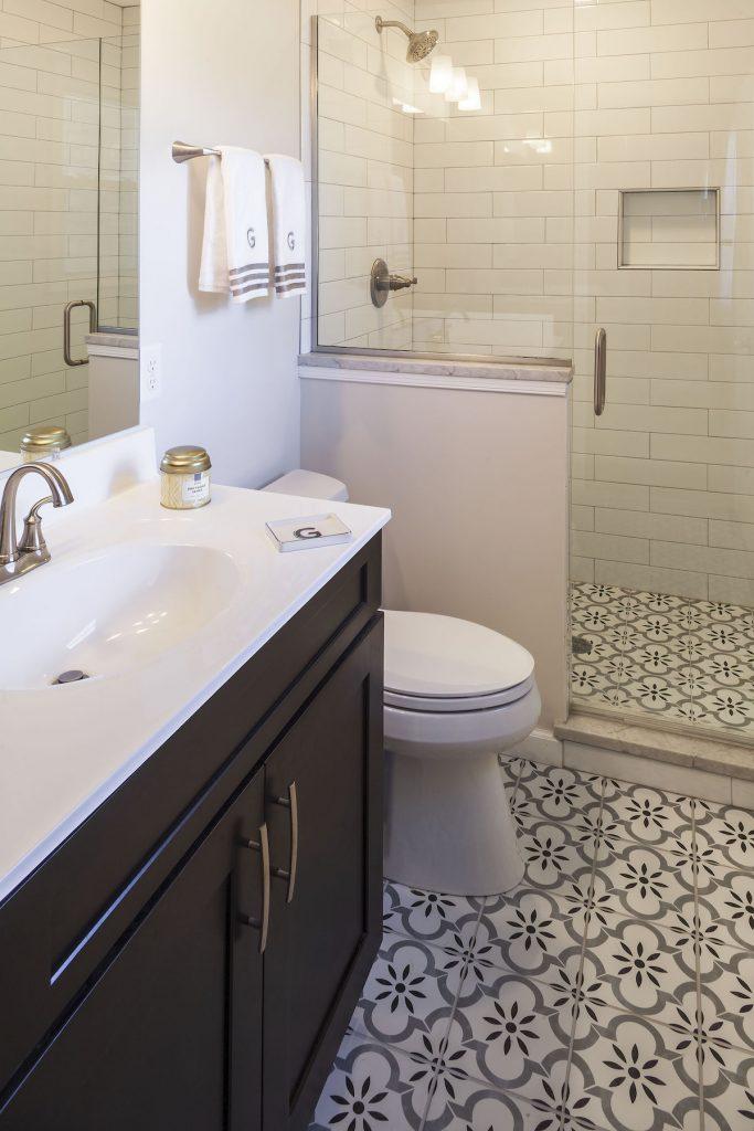gray, black, white patterned tile bathroom flooring