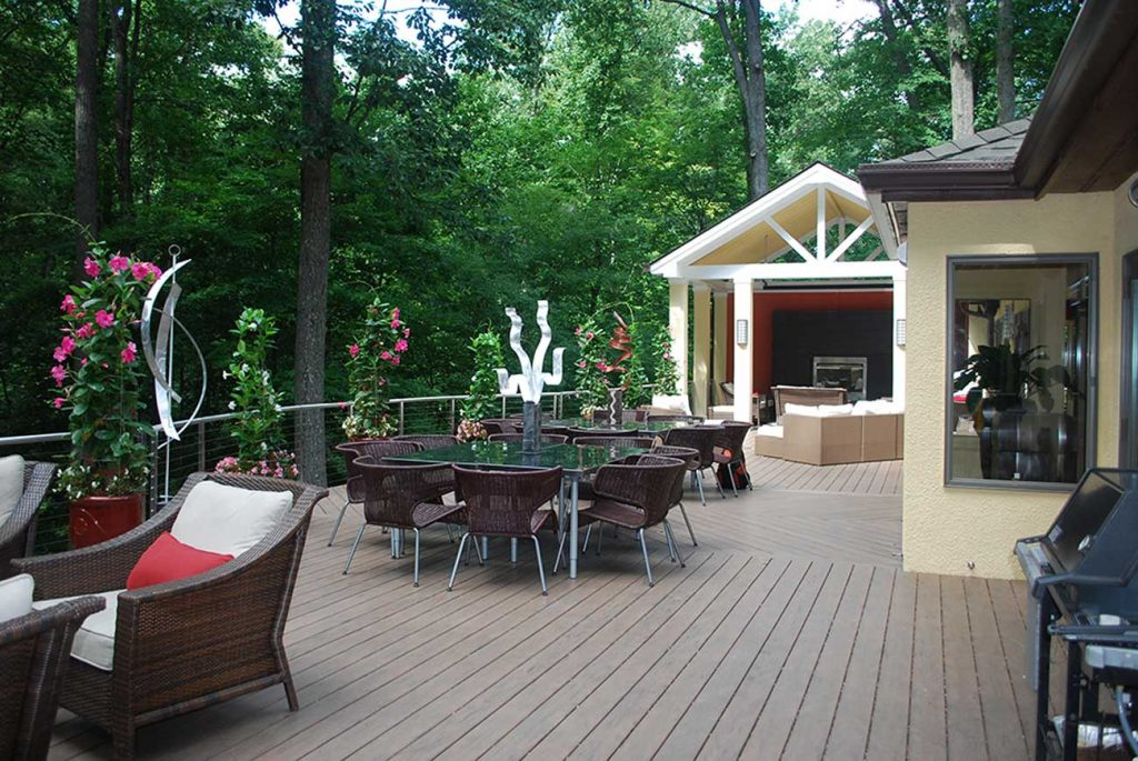 Large deck with lots of seating areas and a loggia.