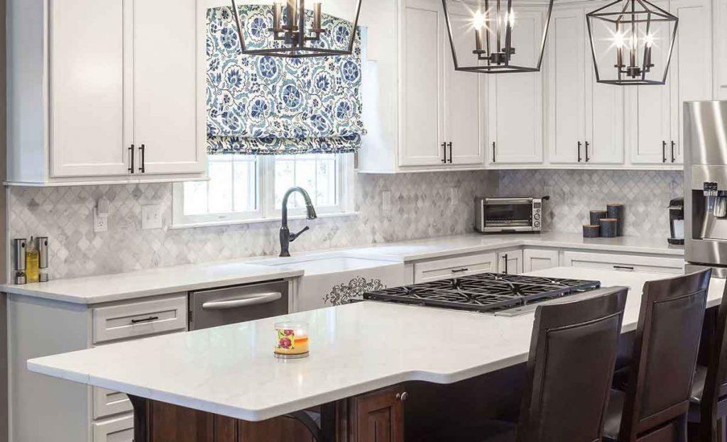 Modern farmhouse kitchen with marble tile backsplash