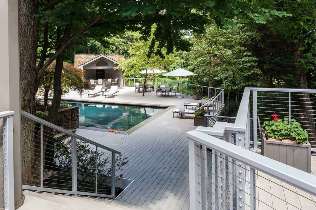 Multi-level deck with wire railing and pool