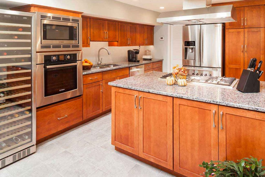 Remodeled kitchen with large island and a wine refrigerator.