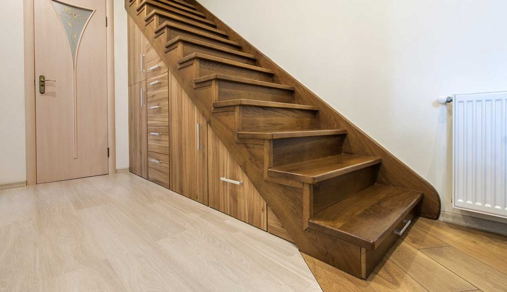 Under stair storage drawers and cubbies